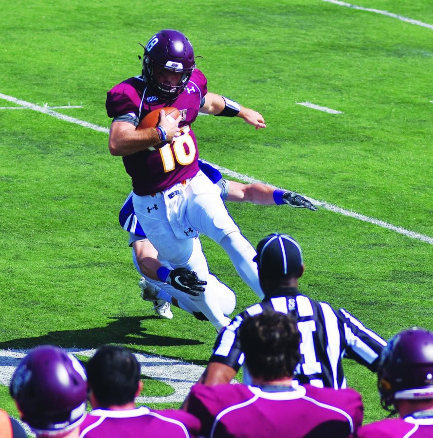 Redshirt freshman quarterback Logan Leiby (pictured above) scrambles out of the pocket in Bloomsburg's opening loss to Stonehill College this past Saturday.