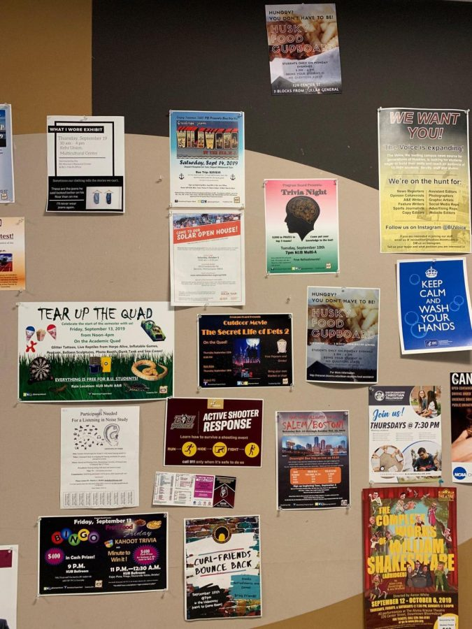 A bulletin board in Kehr Union displaying flyers for different campus events.
