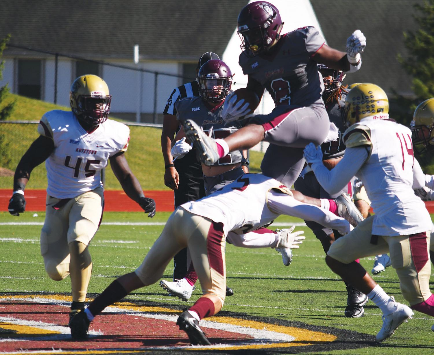 Redshirt junior running back Nyfeast West (pictured above) hurdles the Kutztown defender in the Huskies last game against the Golden Bears this past Saturday.