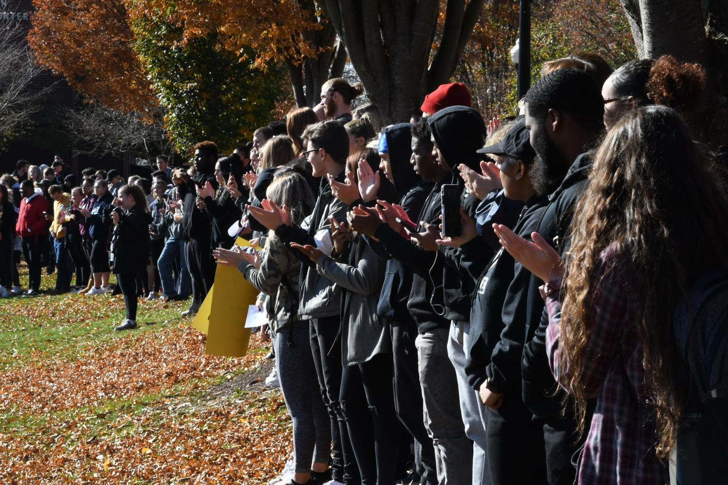 A group of student protestors gather on the quad.