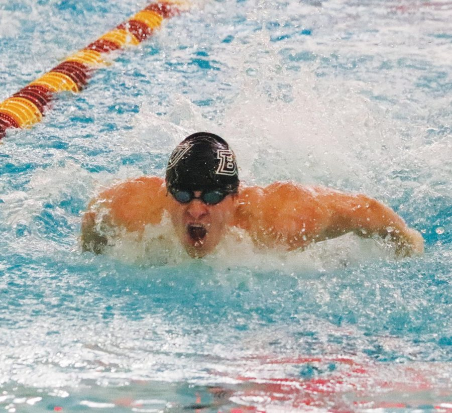A BU team member swims the breaststroke in the medley portion of the race.