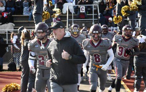 BU head football coach sacked