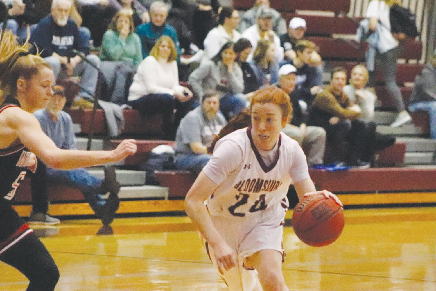 Emma Saxton drives to the lane against Mansfield.