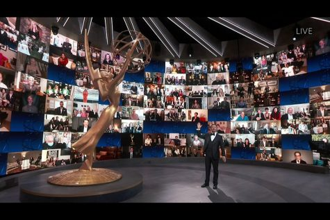 Jimmy Kimmel stands on stage as he hosts the 72nd Emmy Awards. The awards were held virtually this year due to the coronavirus pandemic.