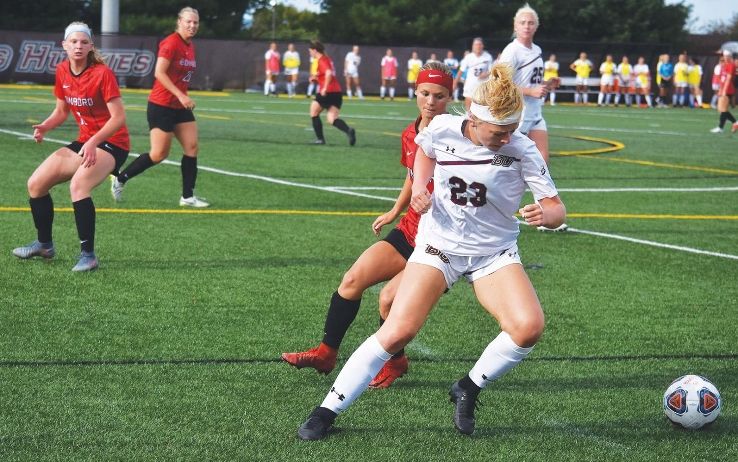 Mindfielder Kimmy Bucher (23) looks to find an opening to make a quick pass during   their match against Edinboro on Sept. 5.