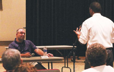 Eric Bower listens to a student at the Talk of the Town Hall Forum on Oct. 22