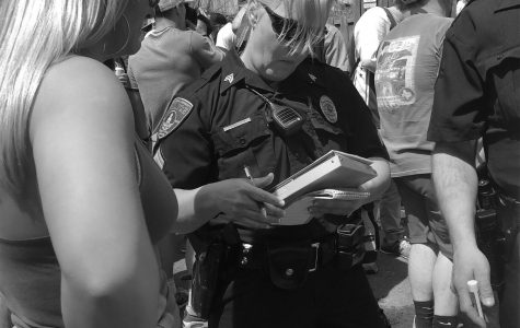 A student receiving a citation at last years Block Party from a BU police officer.