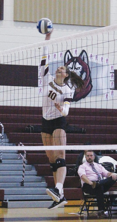 Grace Giza (pictured above) attempts a kill against SRU.