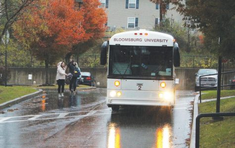 A university bus makes a scheduled stop at the Honeysuckle Apartments Wednesday afternoon.