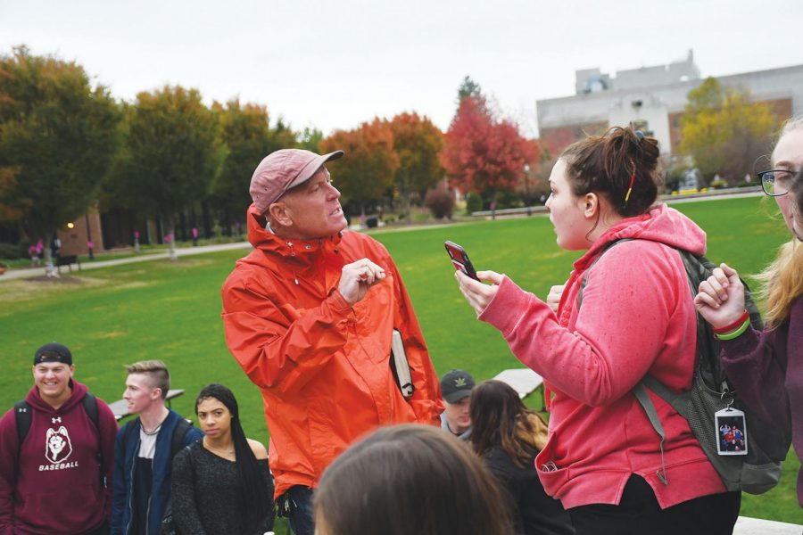 A student and a supporter of the speaker partake in a secondary argument on the  SSC patio.