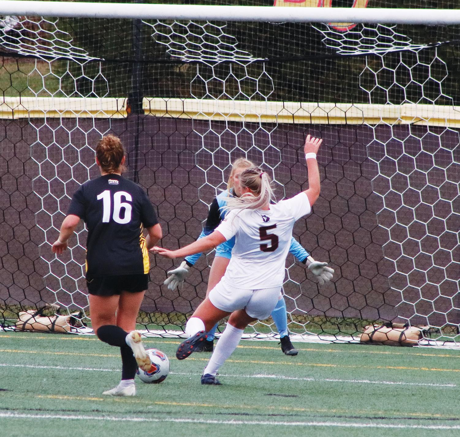 Junior Lauren Hoelke rips in the opening goal in the Huskies 4-0 second round win.