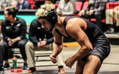 Junior Alex Carida, an NCAA qualifier last season, is tied leading Huskies in wins at two early in the season.